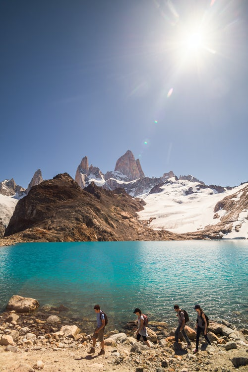 Argentina Travel Landscape Photography Hikers hiking at Lago de los Tres Mount Fitz Roy behind El Chalten Patagonia Argentina South America background with copy space