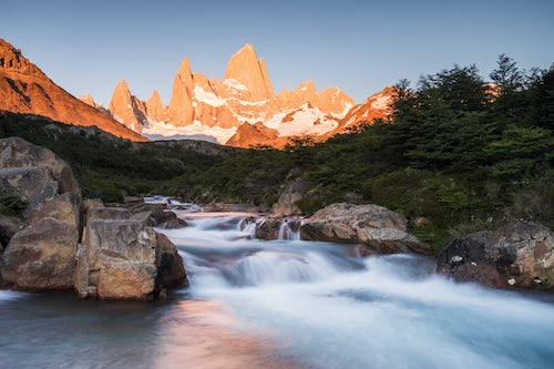 Argentina Travel Landscape Photography Sunrise Mount Fitz Roy aka Cerro Chalten and waterfall seen on Lago de los Tres hike El Chalten Patagonia Argentina South America