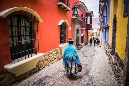 Bolivia Travel Landscape Photography Chollita on Calle Jaen a colourful colonial cobble street in La Paz La Paz Department Bolivia South America