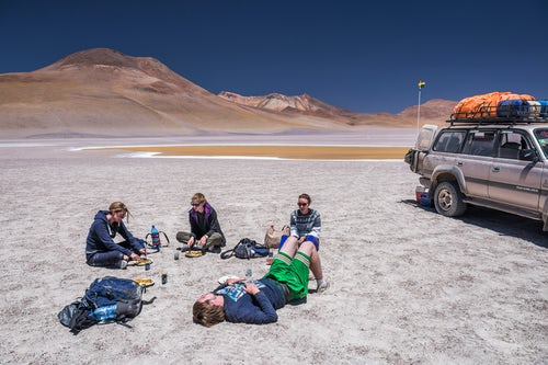 Bolivia Travel Landscape Photography Eating lunch at Laguna Hedionda a salt lake area in the Altiplano of Bolivia South America