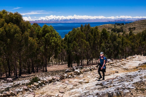 Bolivia Travel Landscape Photography Hiking on Isla del Sol Island of the Sun with Cordillera Real Mountain Range behind Lake Titicaca Bolivia South America