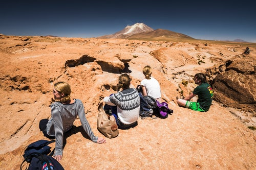 Bolivia Travel Landscape Photography Tourists at Chiguana Desert part of a 3 day tour across the Altiplano of Bolivia South America
