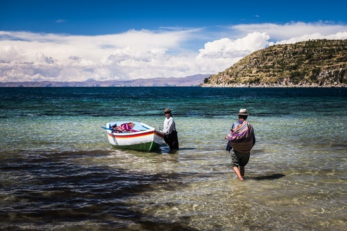 Bolivia Travel Landscape Photography Villagers going fishing on Lake Titicaca at Challapampa village Isla del Sol Island of the Sun Bolivia South America