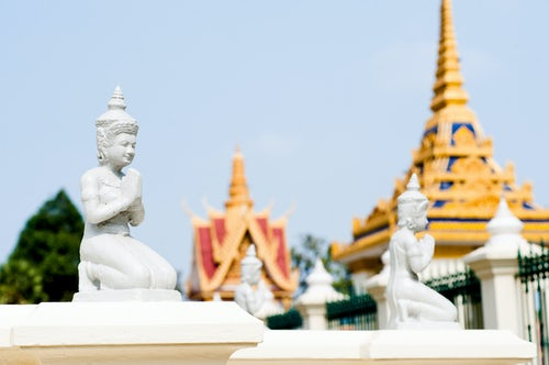 Cambodia Travel Photography Small White Buddha Statues in The Silver Pagoda aka The Temple of the Emerald Buddha at The Royal Palace Phnom Penh Cambodia Southeast Asia