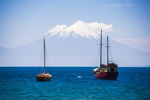 Chile Travel Landscape Photography Capitan Haase Traditional Sailing Ship on Llanquihue Lake with Osorno Volcano behind Puerto Varas Chile Lake District South America