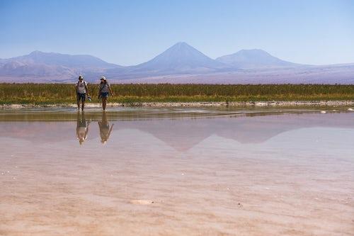 Chile Travel Landscape Photography Laguna Cejar aka floating salt lake lagoon with Licancabur Volcano and Juriques Volcano behind Atacama Desert North Chile South America 2