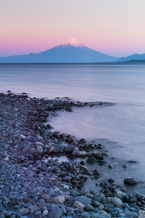 Chile Travel Landscape Photography Sunset at Puerto Varas showing Osorno Volcano and Llanquihue Lake Chile Lake District South America