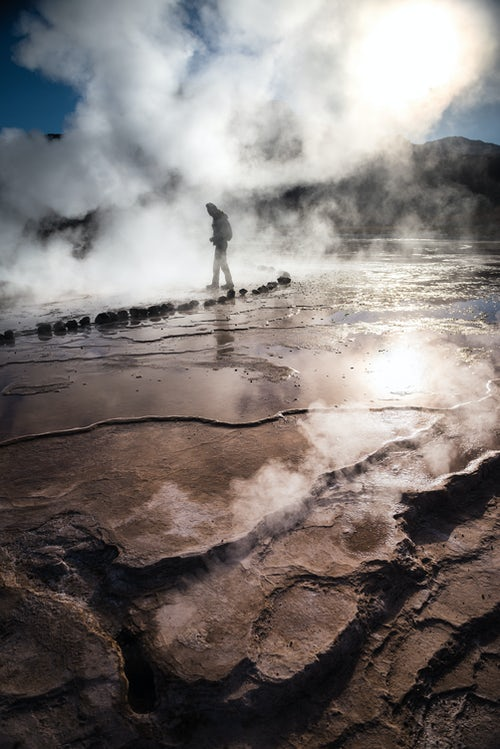 Chile Travel Landscape Photography Tourist at El Tatio Geysers Geysers del Tatio the largest geyser field in the Southern Hemisphere Atacama Desert North Chile South America