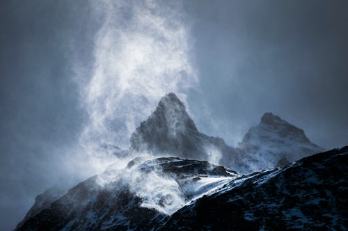 Chile Travel Landscape Photography Wind sweeping snow off mountains Torres del Paine National Park Patagonia Chile South America
