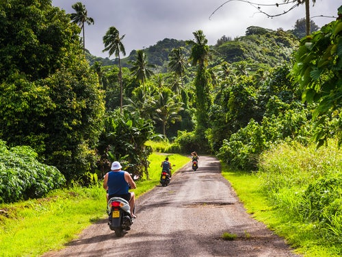 Cook Islands Landscape Travel Photography Moped on the inner circle road to Wigmores waterfall Rarotonga Cook Islands