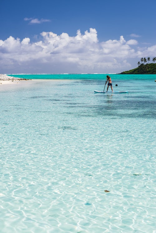 Cook Islands Landscape Travel Photography Paddleboarding in Muri Lagoon Rarotonga Cook Islands background with copy space