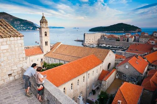 Croatia Travel Photography Tourists sightseeing on Dubrovnik City Walls Dubrovnik Old Town Dalmatia Croatia