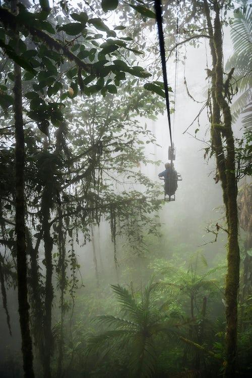 Ecuador Travel Photography Ecuador Mashpi Lodge Sky Bike on a misty morning in the Choco Rainforest an area of Cloud Forest in the Pichincha Province of Ecuador South America