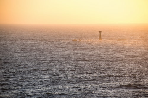 Guernsey Channel Islands Landscape Photography Lighthouse on Guernsey at sunset Channel Islands United Kingdom seascape background with copy space