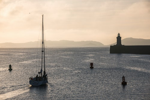 Guernsey Channel Islands Landscape Photography Sailing boat heading out of St Peter Port Harbour at sunrise Guernsey Channel Islands United Kingdom