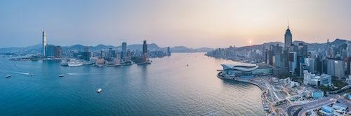 Hong Kong Travel Photography View over Victoria Harbour and Hong Kong at sunset China Drone