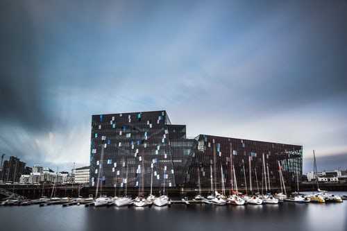 Iceland Travel Photography Harpa Concert Hall and Conference Centre and boats in Reykjavik Harbour Iceland