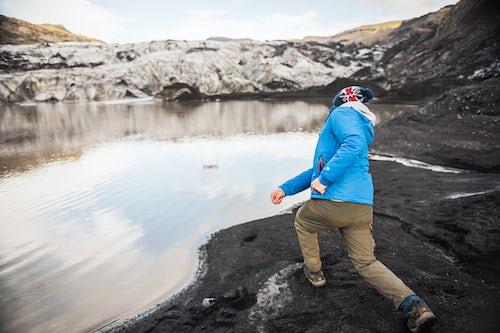 Iceland Travel Photography Skimming stones at Solheimajokull Glacier South Iceland Sudurland