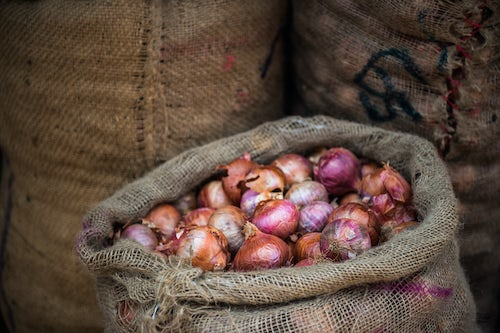 India Travel Photography Onions for sale at a spice market in Fort Kochi Cochin Kerala India
