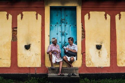 India Travel Street Photography Indian street scene outside a temple Fort Kochi Cochin Kerala India