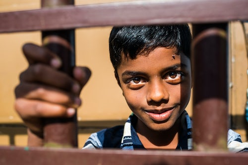 India Travel Street Photography Portrait of an Indian boy in Munnar Western Ghats Mountains Kerala India