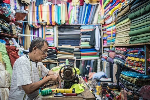 Indonesia Travel Photography Man sewing in Sabang Market Pulau Weh Island Aceh Province Sumatra Indonesia Asia