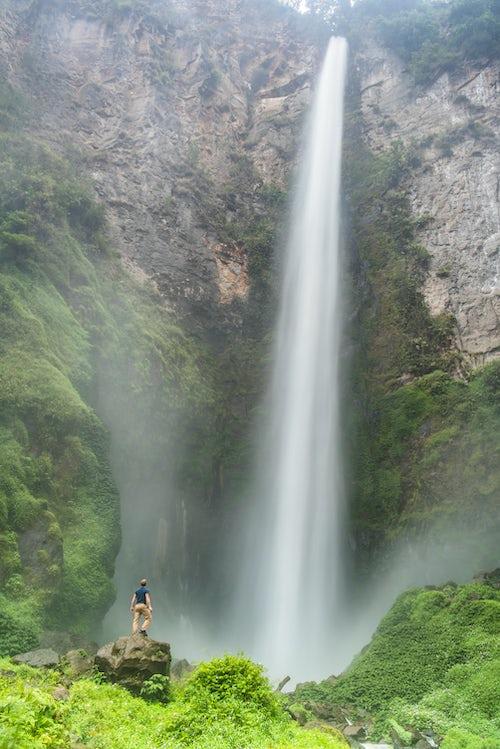 Indonesia Travel Photography Tourist at 120m Sipisopiso Waterfall Lake Toba Danau Toba North Sumatra Indonesia Asia background with copy space
