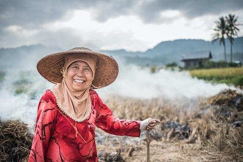 Indonesia Travel Portrait Photography Portrait of a farmer burning crops in rice paddy fields Bukittinggi West Sumatra Indonesia Asia