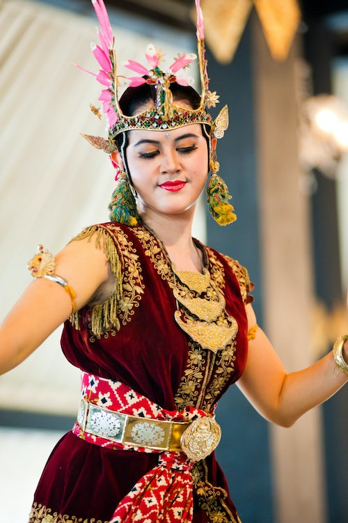 Indonesia Documentary Travel Photography Woman Performing a Traditional Javanese Palace Dance at The Sultans Palace Kraton Yogyakarta Java Indonesia Asia