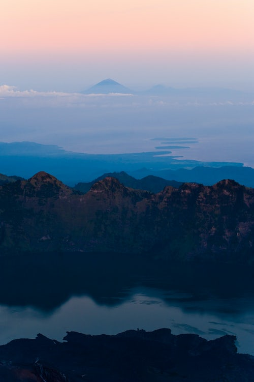 Indonesia Landscape Travel Photography Sunrise View of Mount Segara Anak Lake Mount Agung and the thre Gili Isles from the 3726m Summit of Mount Rinjani Lombok Indonesia Asia