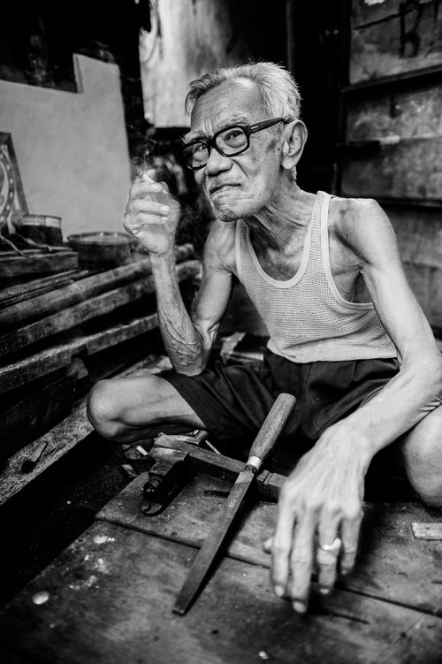 Indonesia Portrait Travel Photography Portrait of an Indonesian Man Taking a Break from Work Water Castle Yogyakarta Central Java Indonesia Asia