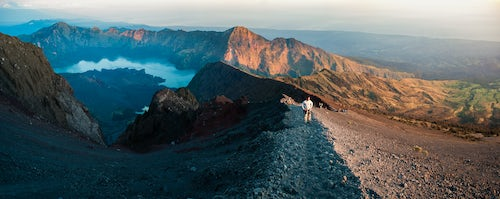 Indonesia Travel Photography Panoramic Photo of a Tourist on the Final Push to the 3726m Summit of Mount Rinjani at Sunrise Lombok Indonesia Asia