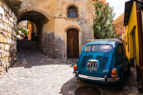 Italy Sicily Travel Photography Fiat 600 on the cobbled side street of Castelmola a typical Sicilian village near Taormina Sicily Italy Europe