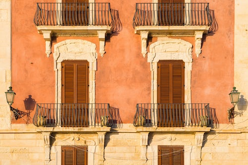 Italy Sicily Travel Photography Ortigia architectural detail of typical Sicilian balconies and shutters Syracuse Siracusa Sicily Italy Europe