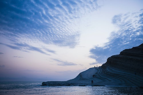 Italy Sicily Travel Photography Scala dei Turchi clouds reflecting the shape of The Turkish Staircase at sunset Rossello cape Realmonte Agrigento Sicily Italy Europe