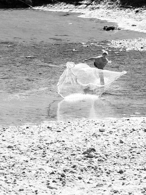Laos Travel Photography Black and White Photo of a Young Boy Fishing Luang Prabang Laos Southeast Asia