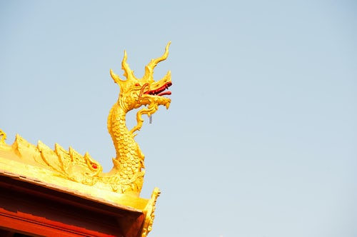 Laos Travel Photography Gold Leaf Naga Figure at Wat Si Saket the Oldest Temple in Vientiane Laos Southeast Asia