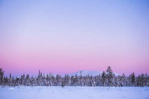 Lapland Finland Landscape Photography Frozen snow covered lake in the winter landscape in Lapland at sunset inside the Arctic Circle in Finland