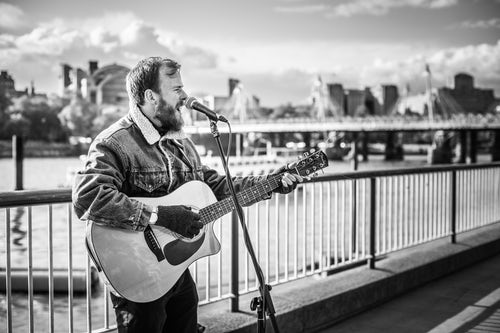 London Street Photography Busker performing on Southbank Southwark London England