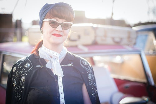 London Street Photography Portrait of a woman in vintage fashion at The Classic Car Boot Sale South Bank London England United Kingdom Europe