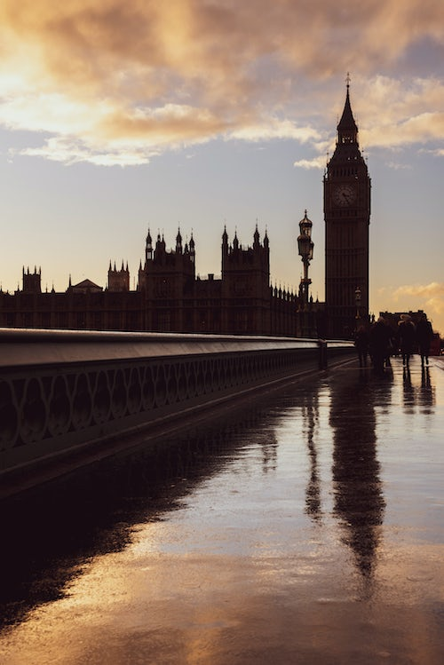 London Travel Photography Houses of Parliament Palace of Westminster and Big Ben silhouetted at sunset seen from Westminster Bridge London England