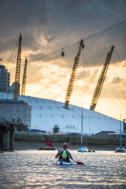 London Travel Photography Kayaking on the River Thames at sunset by the O2 Arena Greenwich London England