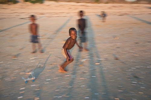 Madagascar Travel Photography Children playing on Ifaty Beach at sunset South West Madagascar Africa