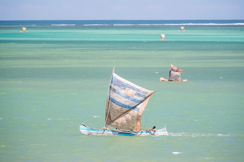 Madagascar Travel Photography Fisherman fishing from a Pirogue a traditional Madagascar sailing boat Ifaty Madagascar Africa