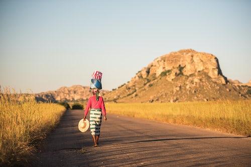 Madagascar Travel Photography Local Madagascan Woman balancing goods on her head Isalo National Park Southwest Madagascar