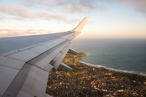Madagascar Travel Photography View of airplane wing at sunset Madagascar Africa