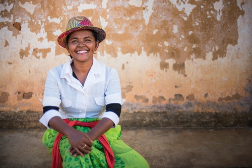 Madagascar Travel Portraiture Portrait Photography Portrait of lady in traditional Malagassy clothes Ambohimahasoa Madagascar Central Highlands