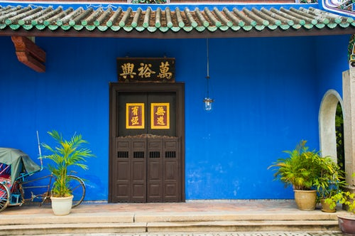 Malaysia Travel Photography Bright Blue Walls and Beautiful Doors at Cheong Fatt Tze Mansion in George Town Penang Malaysia Southeast Asia