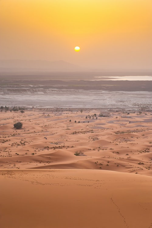 Morocco Travel Landscape Photography Erg Chebbi sunset from the top of a 150m sand dune Sahara Desert near Merzouga Morocco North Africa Africa