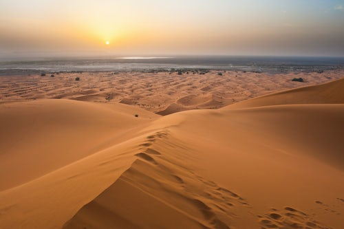 Morocco Travel Landscape Photography Sunset at Erg Chebbi from the top of a 150m sand dune Sahara Desert near Merzouga Morocco North Africa Africa